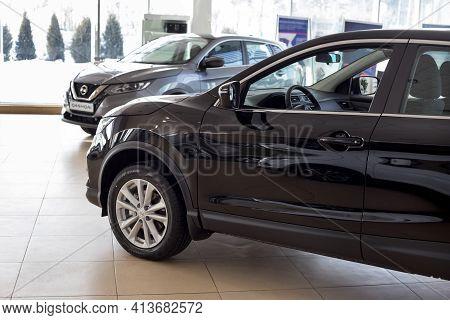 Russia, Izhevsk - February 19, 2021: Nissan Showroom. New Modern Cars In Dealer Showroom. Famous Wor