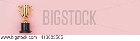 Simply Flat Lay Design Winner Or Champion Gold Trophy Cup Isolated On Pink Pastel Colorful Backgroun