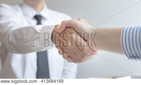 Business people shake hands, Young businessmen shake hands with young women after conversation, Hand