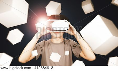 Man Wearing Glasses Of Virtual Reality Headset (vr) Using With Smartphone And Playing Box Game. Conc