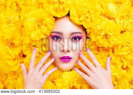 Colorful Fashion Makeup Asian Woman  With Yellow Flower.