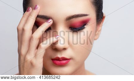 Asian Female Closeup Colorful Eyeshadow With Extreme Long False Eyelashes. Eyelash Extensions. Makeu