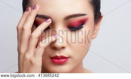 Asian Female Closeup Colorful Eyeshadow With Extreme Long False Eyelashes. Eyelash Extensions. Makeu