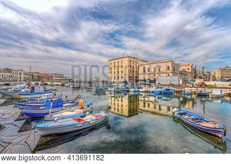 Syracuse Sicily/ Italy -april 11 2020: The Fishermen's Boats Moored In The Canal Of The Ortigia Dock