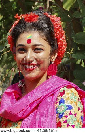 Kolkata, India - March 9th, 2020 : Beautiful Young Lady With Spring Festive Make Up , Smiling At Hol