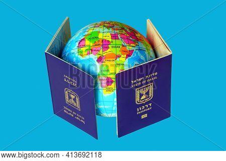 Blue Israeli Biometric And Non Biometric Passport. A Map Or Globe Of Planet Earth. International Tra