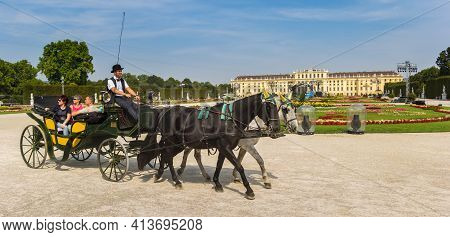 Vienna, Austria - September 16, 2020: Tourists Taking A Tour In A Carriage At The Schonbrunn Palace