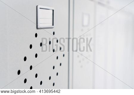 Gray Metal Lockers In The Dressing Room For Clothes In A Row.