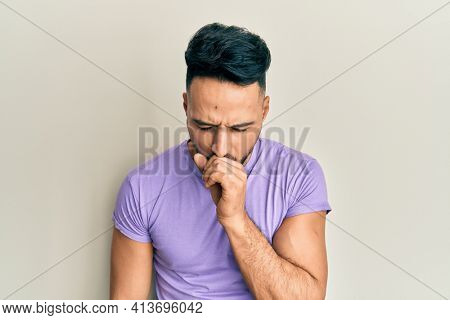 Young arab man wearing casual clothes feeling unwell and coughing as symptom for cold or bronchitis. health care concept.