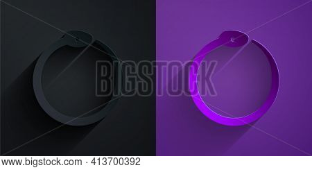 Paper Cut Magic Symbol Of Ouroboros Icon Isolated On Black On Purple Background. Snake Biting Its Ow
