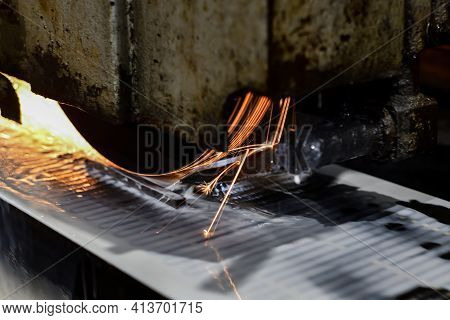 Sparks Rotate On Abrasive Wheels When Metal Is Processed On A Surface Grinder.