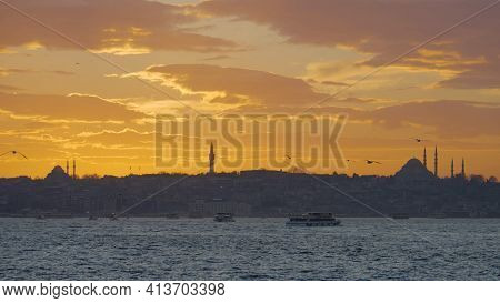 Beautiful Istanbul Landscape With Sunset Background. Action. Dark Coast With Silhouettes Of Mosques