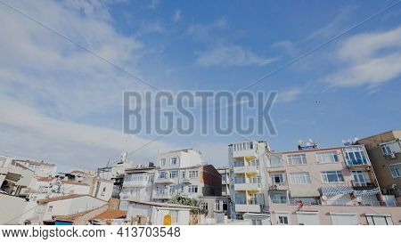 Residential Buildings In Southern Style. Action. Street With Beautiful Residential Buildings On Sunn