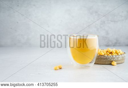 Chickpea Aquafaba. Egg Replacement. Vegan Cooking Concept. Chickpea Water In Glass Cup And Chickpea