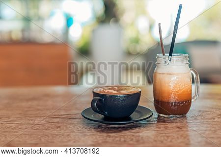 Iced Latte Coffee Glass With Latte Art In Black Mug On Wooden Table In Restaurant And Cafe. Cozy Mor
