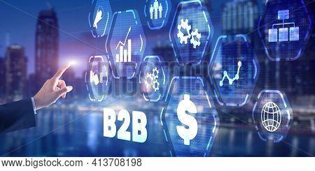 Businessman Presses B2b Icon On Virtual Screen On Modern City Background