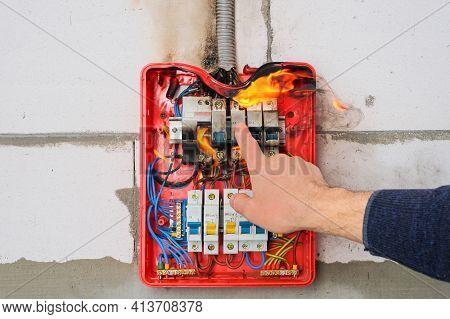 Circuit Breakers On Fire From Overheating Due To Poor Connection Or Poor Quality Wires. Finger Of Ma