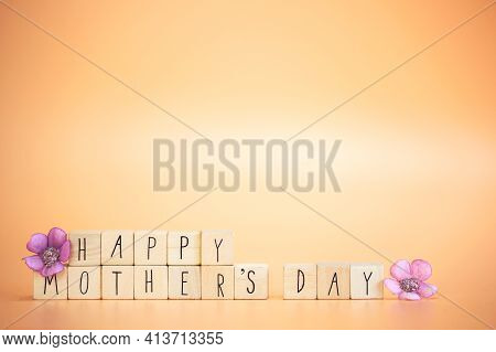 Happy Mother's Day Card. Text Happy Mothers Day On Bright Pastel Orange Colored Background With Colo