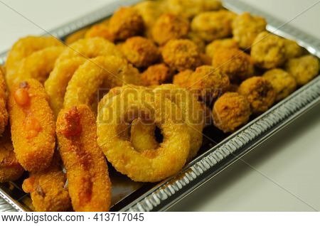 Southern Fried And Roast Chicken Bites, Onion Rings And Mozzarella Stick Served On The Silver Tray