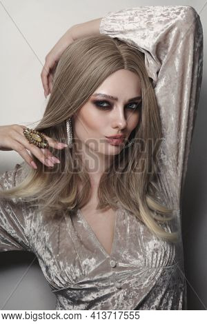 Vintage style portrait of beautiful woman with smoky eye makeup