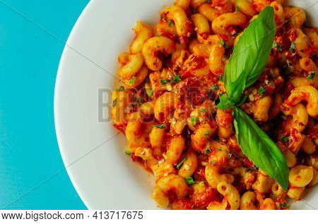 Cooked Cellentani Pasta With Cooked Chicken Breast And Peppers In A Spicy Tomato And Jalapeno Dressi