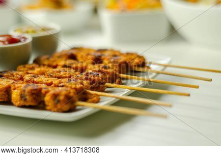 Satay Chicken Breast Marinated In Indonesian Style Spices And Grill On Wooden Skewers With Dip Peanu