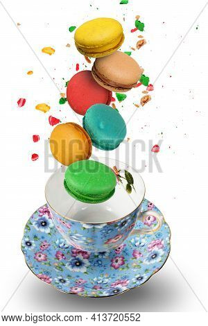 Stack Of Colorful French Macaroons Falling In The  Porcelain Teacup, Isolated On White Background