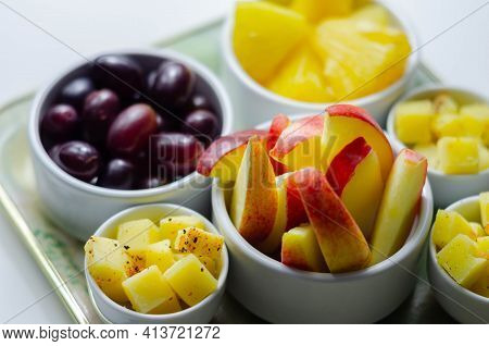 Various Set Fruits, Pineapple, Apple, Grapes With Matured Cheddar Cheese In Bowls