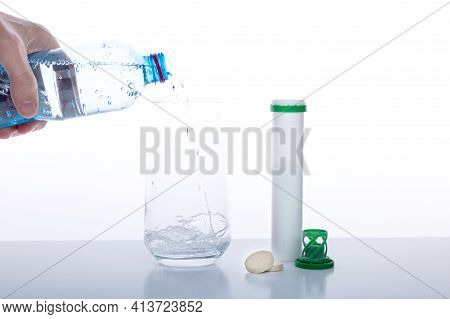Pour Water Into A Glass. Water And Tablets. Bottle Of Water In Hand. Isolate.