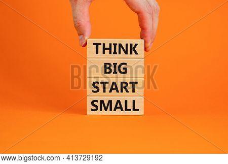 Think Big Start Small Symbol. Concept Words 'think Big Start Small' On Wooden Blocks On A Beautiful