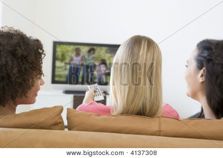 Three Women In Living Room Watching Television