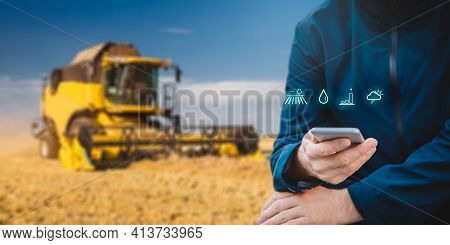 Intelligent Agriculture Concept With Farmer Or Agriculturist Analyze Data About Fields, Humidity, Cr