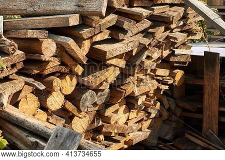 Background Wooden Pallets. Furniture From Pallets. Mountain Of Wood Pallets To Be Crushed In To Mulc
