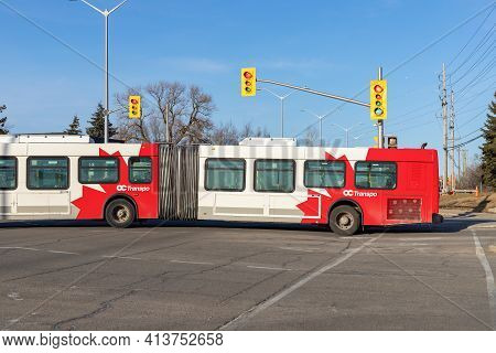 Ottawa, Canada - March 19, 2021: Public Bus Passing Crossroads With Traffic Lights In Canada
