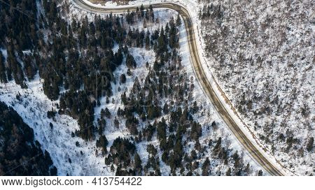 Aerial View Of The River And Taiga Forests And Road In The Winter - Springtime . Abstract Landscape