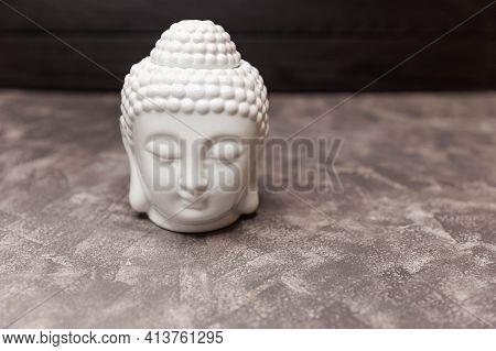 Ceramic Head Of Buddha Statue. Buddha Figurine Decorative Head. Copy, Empty Space For Text. Scandina