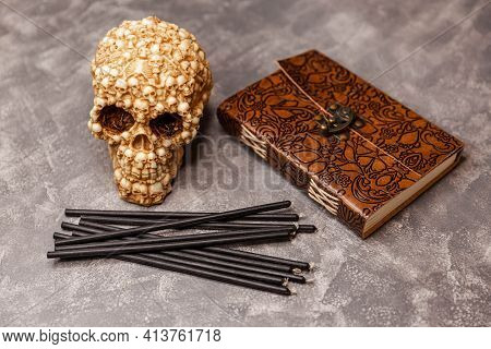 Wicca, Esoteric And Occult Background With Vintage Witch Objects. Objects Skull, Black Candles, Old