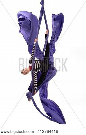 Flexible Girl Doing Aerial Silks Trick On Fabric