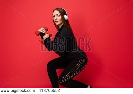Side-profile Photo Of Beautiful Positive Young Brunette Woman Wearing Black Sport Clothes Isolated O