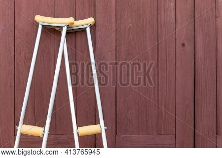 Empty Walking Stick Or Staff Cane For Patient Or Senior Or Elderly People On Wooden Background,healt