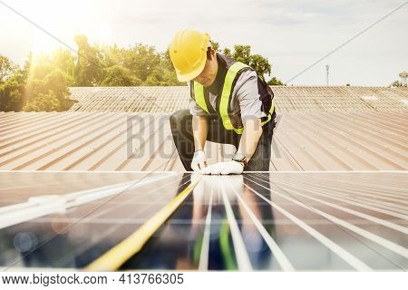 Solar Panel Installation Work Concept : Asian Electrical Engineer Architects Used A Tape Measure To