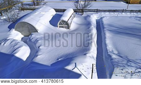 The Greenhouses Are Completely Covered In Snow. Huge Drifts Of Snow At Their Summer Cottage. Snow Co