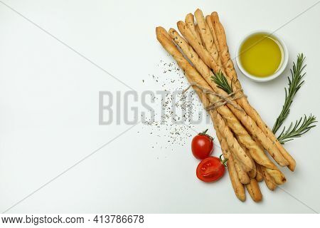 Grissini Breadsticks With Spices On White Background