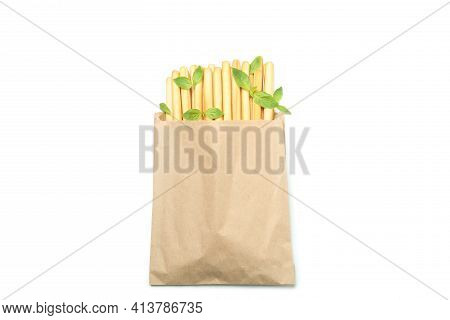 Paper Bag With Grissini Breadsticks Isolated On White Background