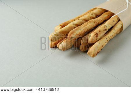 Craft Paper With Grissini Breadsticks On Light Gray Background