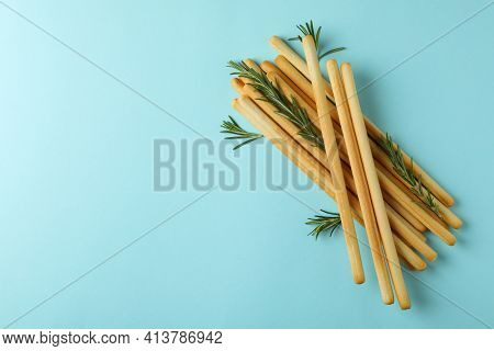 Grissini Breadsticks With Rosemary On Blue Background