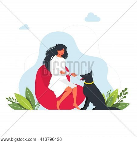 A Girl Is Sitting On A Pouf Chair And And The Big Dog Sits Next To Her. Stay Home Concept. Brunette