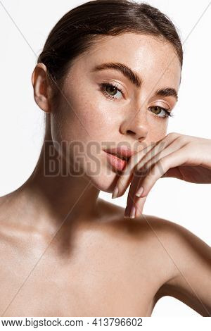 Skin Care. Woman With Beauty Face Touching Healthy Facial Skin Portrait. Beautiful Smiling Girl Mode