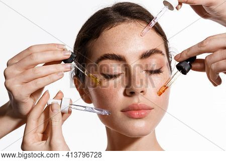 Skin Care And Rejuvenation. Beautiful Model With Radiant And Glowing Facial Skin Looking At Camera.
