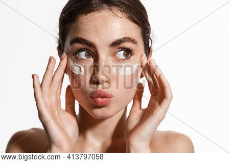 Close Up Beauty Girl With Freckles And Thick Eyebrows, Applying Moisturizing Skincare Cream, Lotion